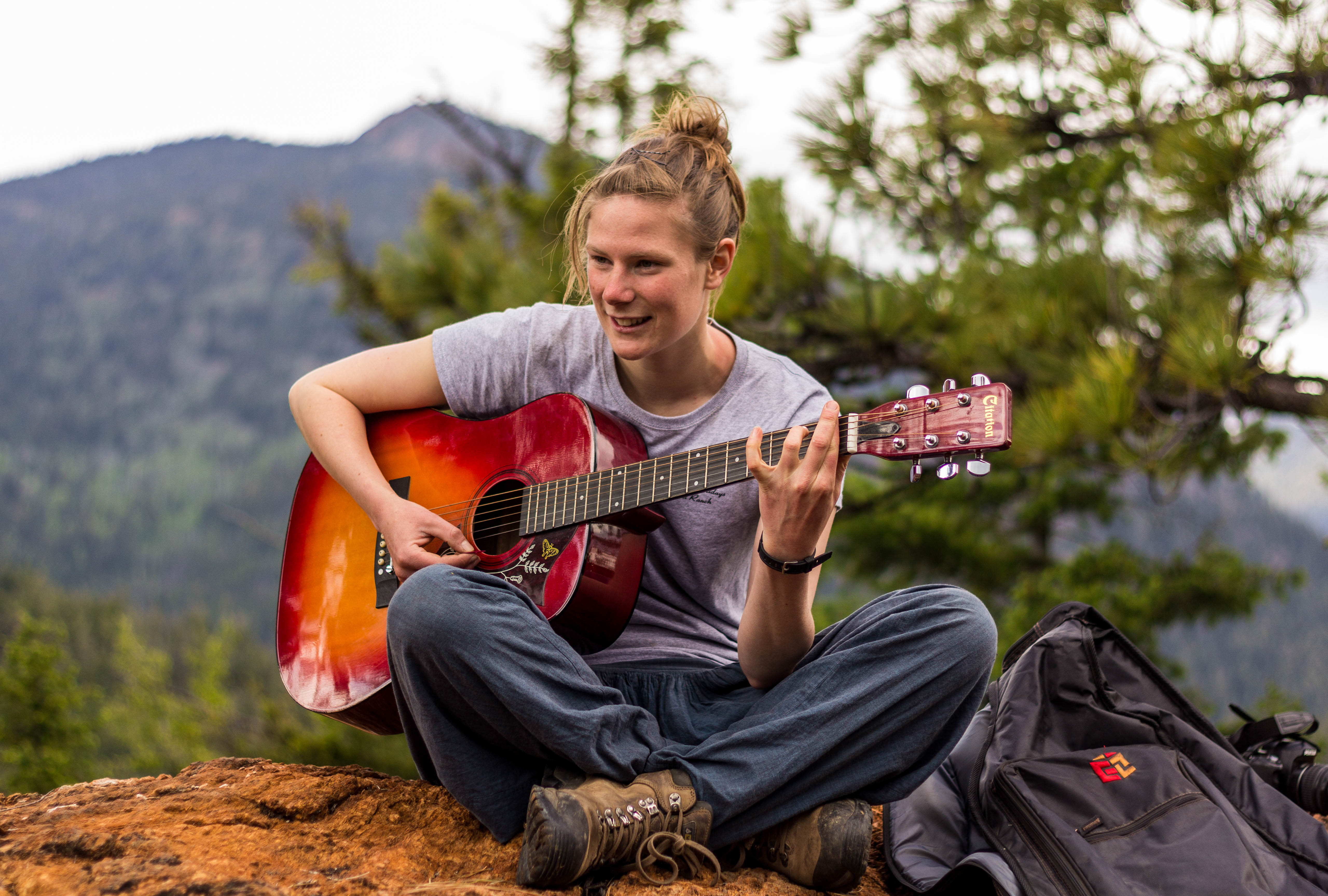 Lea playing the guitar at the Pearson's Lookout